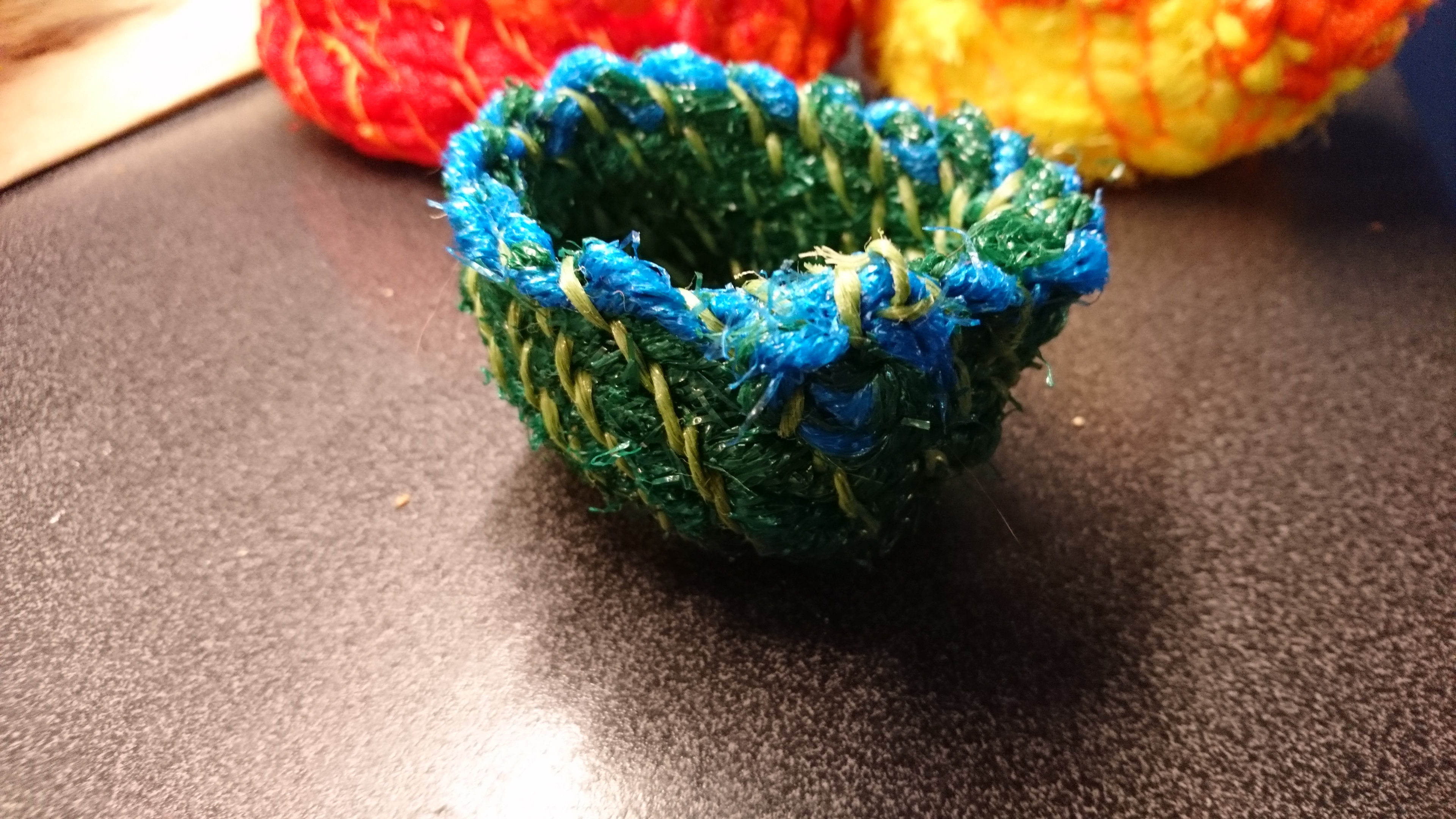 Made with recycled mnetting from fruit and veg.